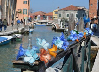 Glass flowers along a canal in Murano